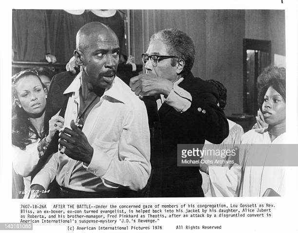 Alice Jubert and Fred Pinkhard help Lou Gossett Jr into his jacket in a scene from the film 'JD's Revenge' 1976
