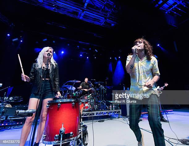 Alice Katz and Sam Martin of Youngblood Hawke perform onstage at The Greek Theatre on August 26 2014 in Los Angeles California