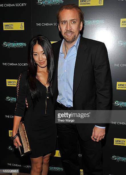 Alice Kim and Nicolas Cage attend the Cinema Society Amnesty International screening of 'The Sorcerer's Apprentice' at the Tribeca Grand Hotel on...