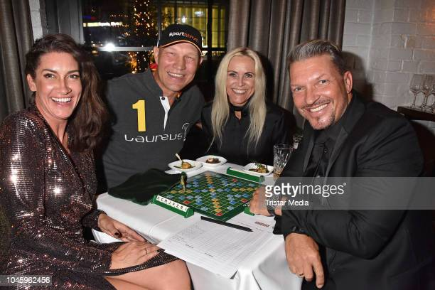 Alice Krueger Axel Schulz Patricia Schulz and Hardy Krueger Jr attend the charity event PLACE TO B Playing for Charity at Restaurant GRACE on October...