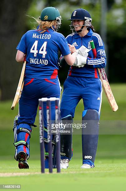 Alice MacLeod and Caroline Atkins of England celebrate victory during an International T20 match between England Women's Academy and India at...