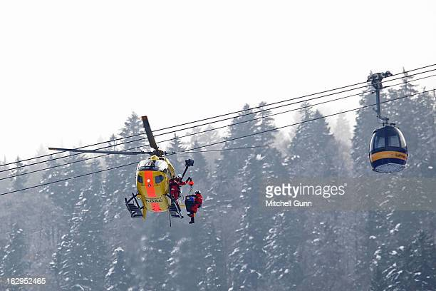 Alice McKennis of the USA is loaded into the emergency helicopter after crashing out of the Audi FIS Ski World Cup downhill race on March 02 2013 in...