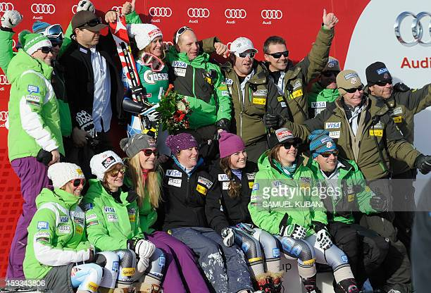 Alice McKennis of US celebrates her first place on podium with her teammates of the women's World Cup downhill on January 122012 in St Anton am...
