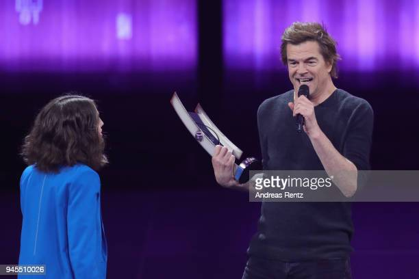 Alice Merton and 'Rock National' award winner Campino of Die Toten Hosen are seen on stage during the Echo Award show at Messe Berlin on April 12...