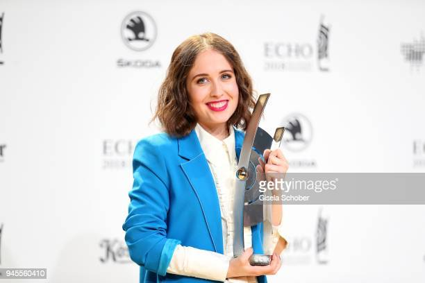 Alice Merton poses with award during the Echo Award winners board at Messe Berlin on April 12 2018 in Berlin Germany