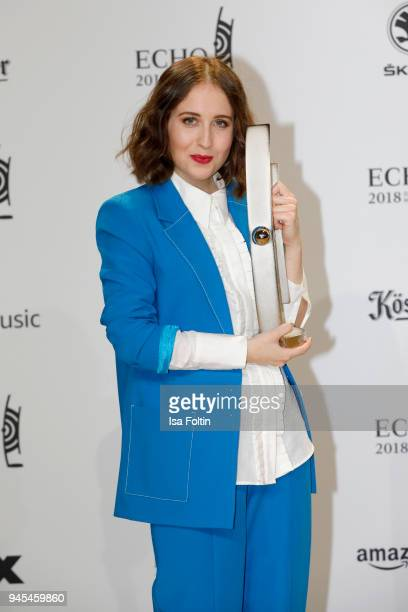 Alice Merton poses with her award for National Pop Female Artist during the Echo Award winners board at Messe Berlin on April 12 2018 in Berlin...