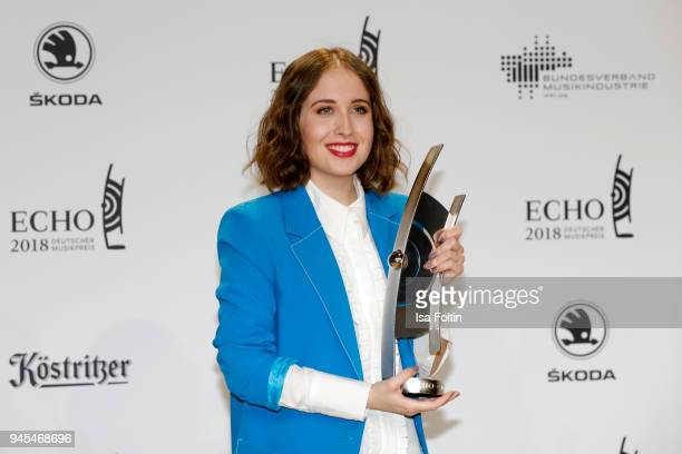 Alice Merton poses with her award for 'National Pop Female Artist' during the Echo Award winners board at Messe Berlin on April 12 2018 in Berlin...