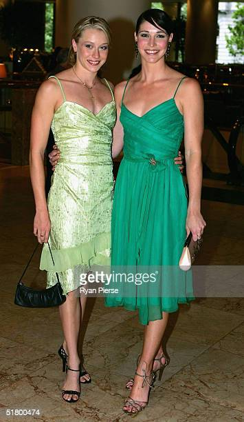 Alice Mills and Giaan Rooney arrive at the Telstra Swimmer Of The Year Awards at the Grand Hyatt Hotel November 29 2004 in Melbourne Australia