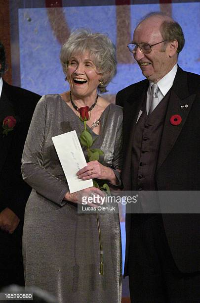 Alice Munro accepts the 2004 Giller Prize beside founder Jack Rabinovitch for her collection of short stories entitled 'Runaway' Thursday night at...
