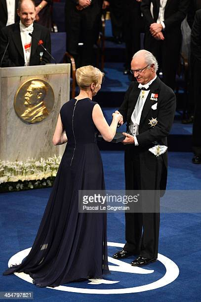 Alice Munro laureate of the Nobel Prize in Literature represented by her daughter Jenny Munro receives her Nobel Prize from King Carl XVI Gustaf of...