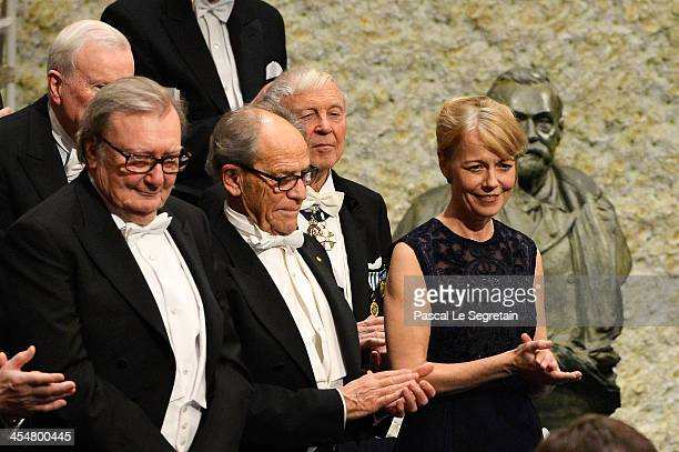 Alice Munro laureate of the Nobel Prize in Literature represented by her daughter Jenny Munro acknowledges applause after she received her Nobel...