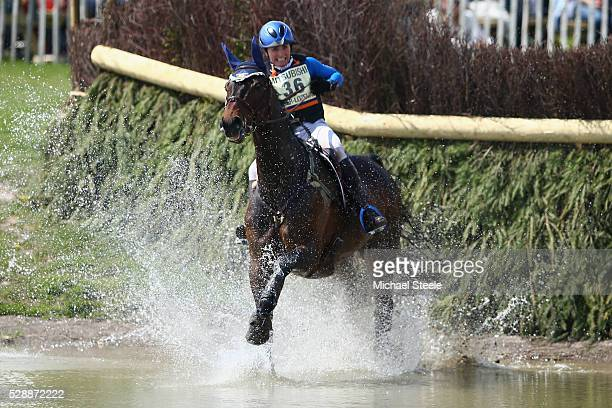 Alice NaberLozeman of Holland riding Harry Belafonte at the lake fence during the crosscountry test on day four of the Badminton Horse Trials on May...