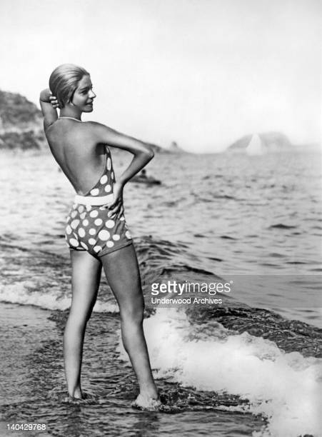 Alice Nikitina, well known Russian ballet dancer, teacher, and opera singer wearing one of her striking bathing suits at the beach in Italy, Alassio,...