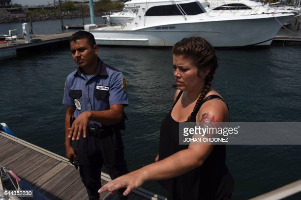 Alice Ottz a member of the Dutch organization Women on Waves speaks with a private guard at the Pez Vela Marina in the port of San Jose Escuintla...
