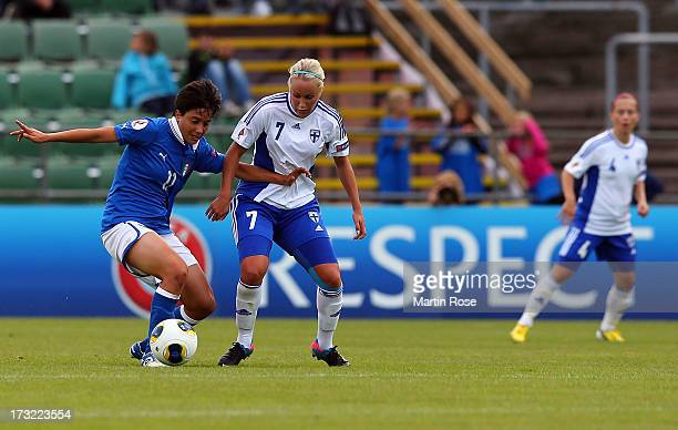 Alice Parisi of Italy battles for the ball with Annika Kukkonen of Finland during the UEFA Women's Euro 2013 group A match at Orjans Vall on July 10...