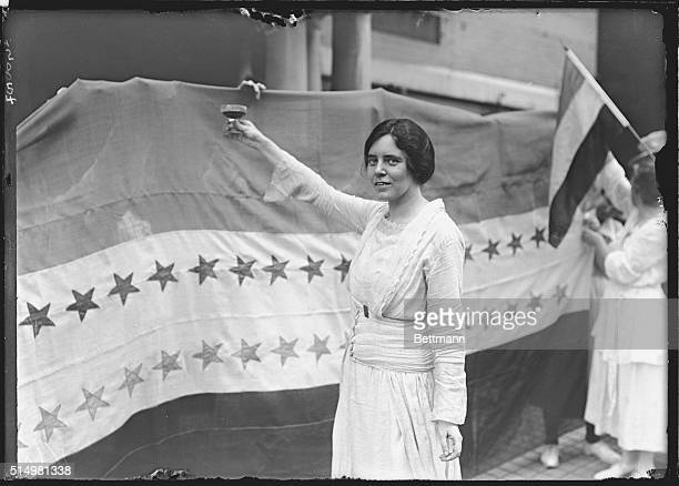 Alice Paul makes a toast to Tennessee's ratification of the 19th Amendment to the US Constitution giving women the right to vote The banner beside...