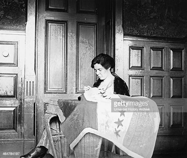 Alice Paul sewing suffrage flag