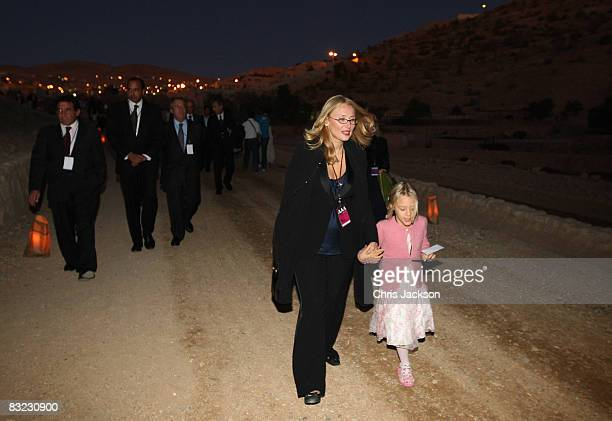 Alice Pavarotti and her mother Nicoletta Pavarotti take part in a candle lit walk to a memorial service in the ancient ruins of Petra to celebrate...