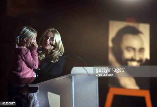 Alice Pavarotti wipes away a tear as she summons up the courage to talk whilst in the arms of her mother Nicoletta Pavarotti as they attend a...