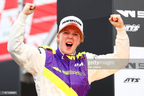 Alice Powell of Great Britain celebrates victory on the podium after winning the W Series round six and final race of the inaugural championship at...