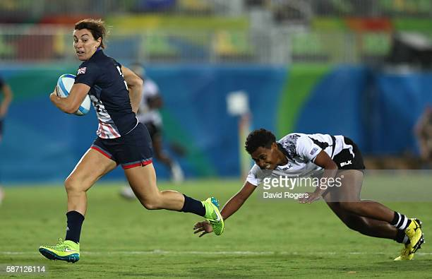 Alice Richardson of Great Britain escapes a tackle to score a try against Fiji during the Women's Quarterfinal rugby match on Day 2 of the Rio 2016...