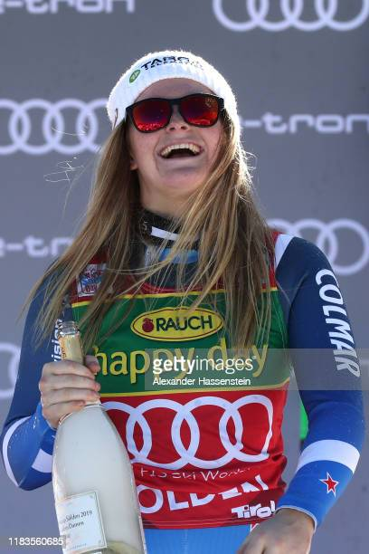Alice Robinson of New Zealand celebrates winning the Audi FIS Alpine Ski World Cup Women's Giant Slalom during the flower ceremony for the Audi FIS...