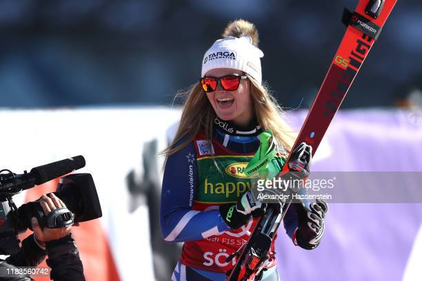 Alice Robinson of New Zealand celebrates winning the Audi FIS Alpine Ski World Cup - Women's Giant Slalom during the flower ceremony for the Audi FIS...