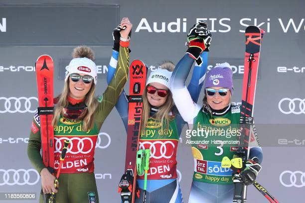 Alice Robinson of New Zealand celebrates winning the Audi FIS Alpine Ski World Cup Women's Giant Slalom next tow Mikaela Shiffrin of USA and Tessa...