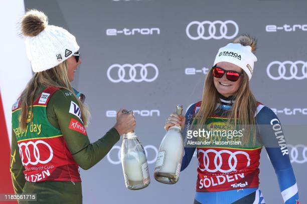 Alice Robinson of New Zealand celebrates winning the Audi FIS Alpine Ski World Cup Women's Giant Slalom with Mikaela Shiffrin of USA during the...