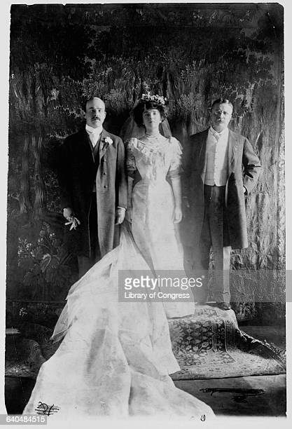 Alice Roosevelt daughter of President Theodore Roosevelt stands with her father and her new husband Congressman Nicholas Longworth