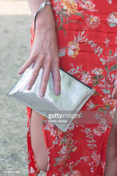Alice Sanders wears a Topshop dress and And Other Stories clutch bag during Wilderness Festival 2018 at Cornbury Park on August 5 2018 in Oxford...