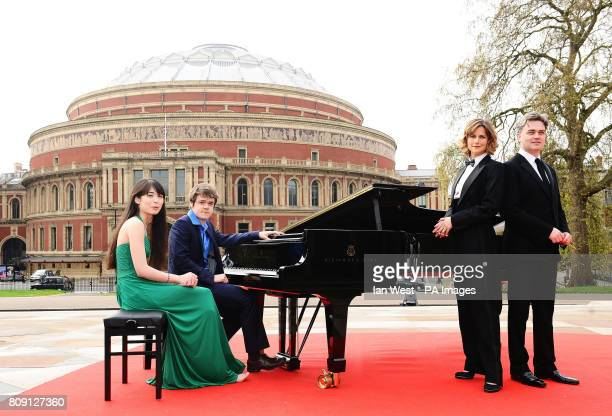 Alice Sara Ott Benjamin Grosvenor Katie Derham and Conductor Edward Gardner help launch the BBC Proms 2011 on the Albert Memorial in London