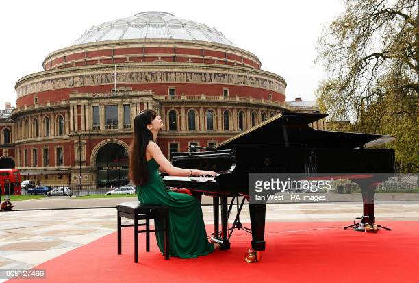 Alice Sara Ott performs outside the Royal Albert Hall to launch the BBC Proms 2011 on the Albert Memorial in London