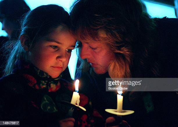 Alice Sheehan and daughter Kelly of Hull attend a candlelight vigil on Nantasket Beach for the victims of Columbine High School shooting Around 250...