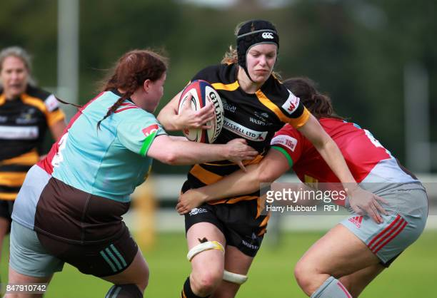 Alice Sheffield of Wasps FC Ladies and Chloe Edwards of Harlequins Ladies and Amy Garrett of Harlequins Ladies in action during the Tyrrells Premier...