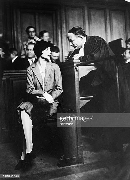 Alice Silverthrone, Countesse de Janze, on trial for the shooting of Raymond Trafford , consulting with her barrister.