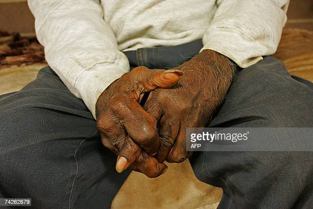 TO GO WITH AUSTRALIAABORIGINESSCHEDFEATURE by Neil Sands This picture taken 17 May 2007 shows Aboriginal elder Stanly George folding his hands as he...