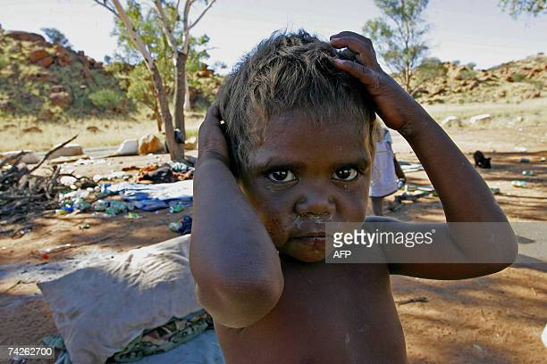 TO GO WITH AUSTRALIAABORIGINESSCHEDFEATURE by Neil Sands This picture taken 20 May 2007 shows Aboriginal child Leam Robertson one of the residents at...