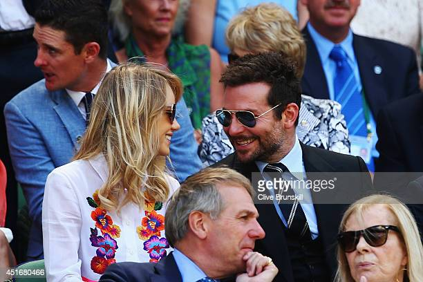 Alice Suki Waterhouse and Bradley Cooper in the royal box for the Gentlemen's Singles semifinal match between Novak Djokovic of Serbia and Grigor...