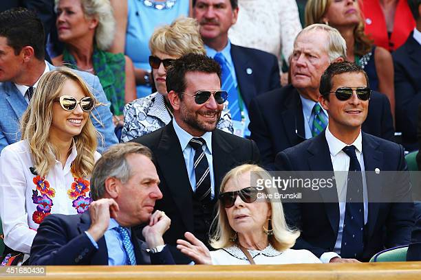 Alice Suki Waterhouse Bradley Cooper and Bear Grylls in the royal box for the Gentlemen's Singles semifinal match between Novak Djokovic of Serbia...