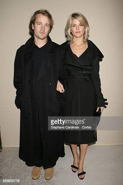 Alice Taglioni and Jocelyn Quivrin attend the Christian Dior readytowear SpringSummer 2006 fashion show