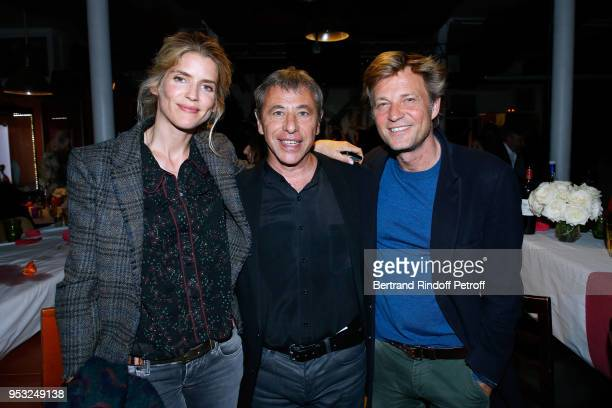 Alice Taglioni Organizer of the event LouisMichel Colla and Laurent Delahousse attend the Dinner in honor of Nathalie Baye at La Chope des Puces on...