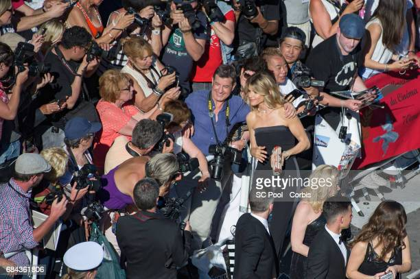 Alice Taglioni poses for selfies as she attends the 'Ismael's Ghosts ' screening and Opening Gala during the 70th annual Cannes Film Festival at...
