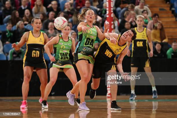 Alice Teague-Neeld of the Fever and Dylan McPherson of the All-Stars contest for the ball during the netball exhibition match between the West Coast...