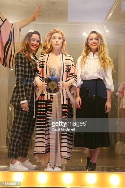 Alice Temperley Amber Heard attends a photocall to unveil the new 'Alice In Wonderland' themed window at Temperley London on February 20 2015 in...