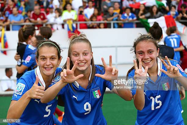 Alice Tortelli Nicole Garavelli and Annamaria Serturini of Italy celebrate after winning the FIFA U17 Women's World Cup 2014 3rd place play off match...