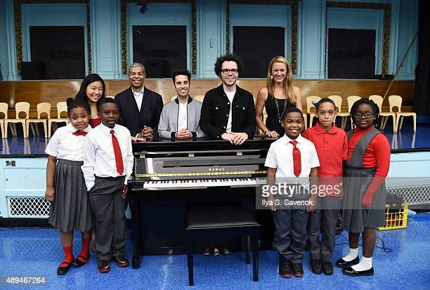 Alice Tsui Paul Cothran Chad King Ian Axel and Nicki Maher pose with kids during A Great Big World celebrates VH1 Save The Music Keys and Kids piano...