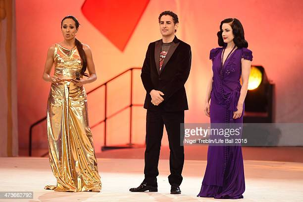 Alice Tumler Dita von Teese and Juan Diego Florez on stage during the Life Ball 2015 show at City Hall on May 16 2015 in Vienna Austria