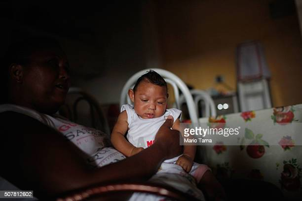 Alice Vitoria Gomes Bezerra 3monthsold who has microcephaly is held by her mother Nadja Cristina Gomes Bezerra sits on January 31 2016 in Recife...