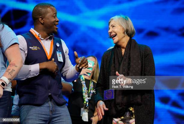 Alice Walton daughter of Walmart founder Sam Walton dances with Walmart associate Antonio Williams onstage during the annual shareholders meeting...
